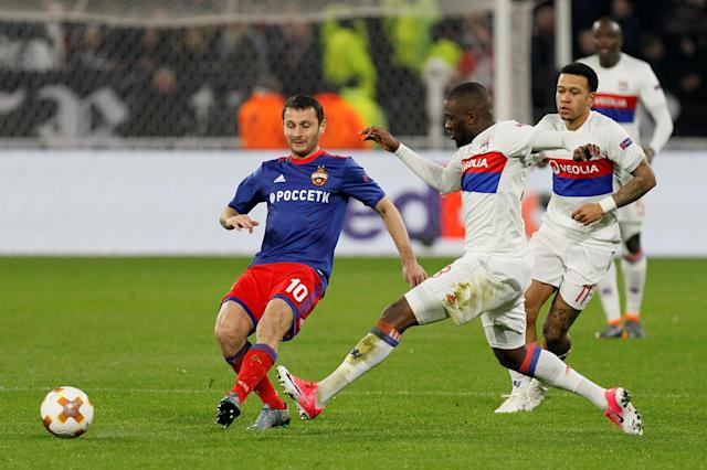 Soccer Football - Europa League Round of 16 Second Leg - Olympique Lyonnais vs CSKA Moscow - Groupama Stadium, Lyon, France - March 15, 2018 CSKA Moscow's Alan Dzagoev in action with Lyon's Tanguy Ndombele and Memphis Depay REUTERS/Emmanuel Foudrot