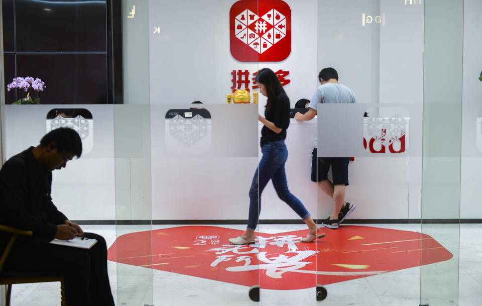 SHANGHAI, CHINA - JULY 25: Employees work at Pinduoduo headquarters on July 25, 2018 in Shanghai, China. Chinese online group discounter Pinduoduo Inc. (PDD) was listed on the Nasdaq Stock Market on Thursday. (Photo by Visual China Group via Getty Images)
