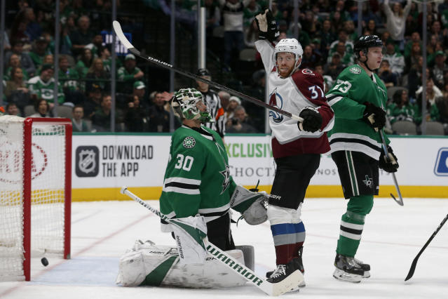 Colorado Avalanche left wing J.T. Compher (37) celebrates a goal by teammate Ian Cole, not pictured, in front of Dallas Stars goaltender Ben Bishop (30) during the second period of an NHL hockey game in Dallas, Saturday, Dec. 28, 2019. (AP Photo/Michael Ainsworth)