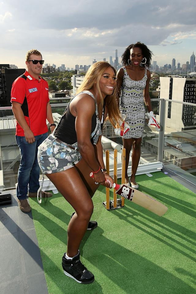 MELBOURNE, AUSTRALIA - JANUARY 09: Venus Williams of the USA is coached in cricket batting by Aaron Finch of the Melbourne Renegades during a meet & greet with the Melbourne Renegades at The Olsen on January 9, 2014 in Melbourne, Australia. (Photo by Graham Denholm/Getty Images)