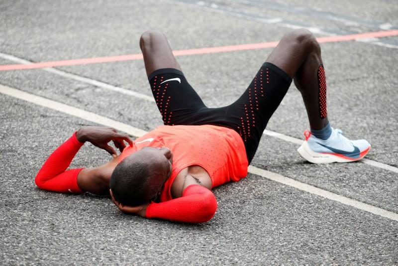 FILE PHOTO: Kipchoge reacts after crossing  the finish line during an attempt to break the two-hour marathon barrier at the Monza circuit.