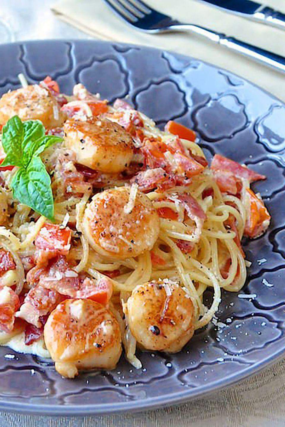 """<p>Kick your spaghetti up a notch with a dish that is quick, easy, and full of flavor.</p><p><strong>Get the recipe at <a href=""""http://www.rockrecipes.com/creamy-garlic-scallop-spaghetti-with-bacon/"""" rel=""""nofollow noopener"""" target=""""_blank"""" data-ylk=""""slk:Rock Recipes"""" class=""""link rapid-noclick-resp"""">Rock Recipes</a>.</strong></p>"""