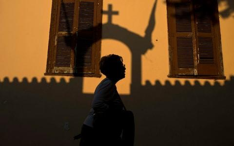The new law on gender declaration has been fiercely opposed by the Greek Orthodox Church. The shadow of a church is seen in Plaka, a historic district of Athens. - Credit: AP