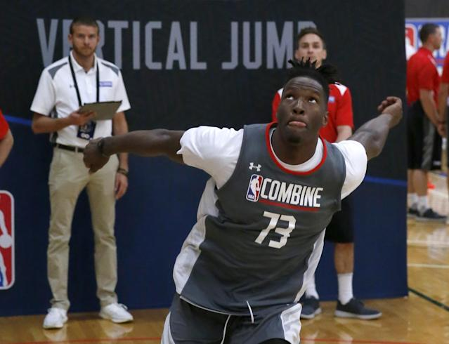 """Former Wisconsin forward <a class=""""link rapid-noclick-resp"""" href=""""/ncaab/players/120669/"""" data-ylk=""""slk:Nigel Hayes"""">Nigel Hayes</a> participates in the running vertical jump at the 2017 NBA draft combine in Chicago. (AP)"""