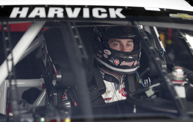 Kevin Harvick prepares for practice for Saturday's NASCAR Sprint Cup series auto race at Charlotte Motor Speedway in Concord, N.C., Thursday, Oct. 10, 2013. (AP Photo/Chuck Burton)