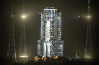 A Long March-5 rocket sits on the launch pad at the Wenchang Space Launch Center in Wenchang in southern China's Hainan Province, early Tuesday, Nov. 24, 2020. Chinese technicians are making final preparations for a mission to bring back material from the moon's surface for the first time in more than four decades, an undertaking that could boost human understanding of the moon and of the solar system more generally. (AP Photo/Mark Schiefelbein)
