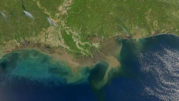 Sediment-laden water pours into the northern Gulf of Mexico from the Atchafalaya River in Louisiana.