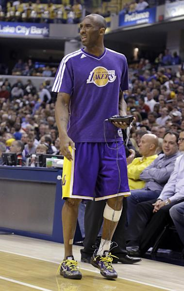 Los Angeles Lakers guard Kobe Bryant gets treatment on his injured ankle during the second half of an NBA basketball game against the Indiana Pacers in Indianapolis, Friday, March 15, 2013. The Lakers defeated the Pacers 99-93. Bryant did not play in the second half. (AP Photo/Michael Conroy)