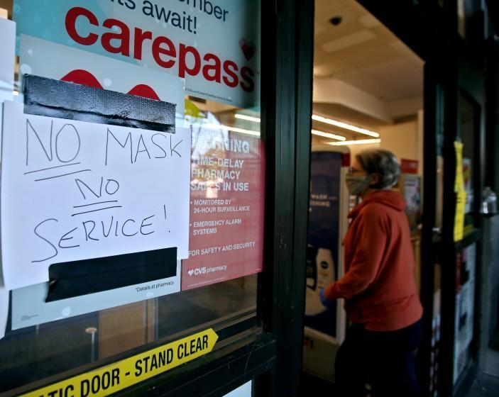 The CVS store on the 500 block of N. Hollywood Way has a sign reminding customers to wear a face mask, in Burbank on Wednesday, April 15, 2020.