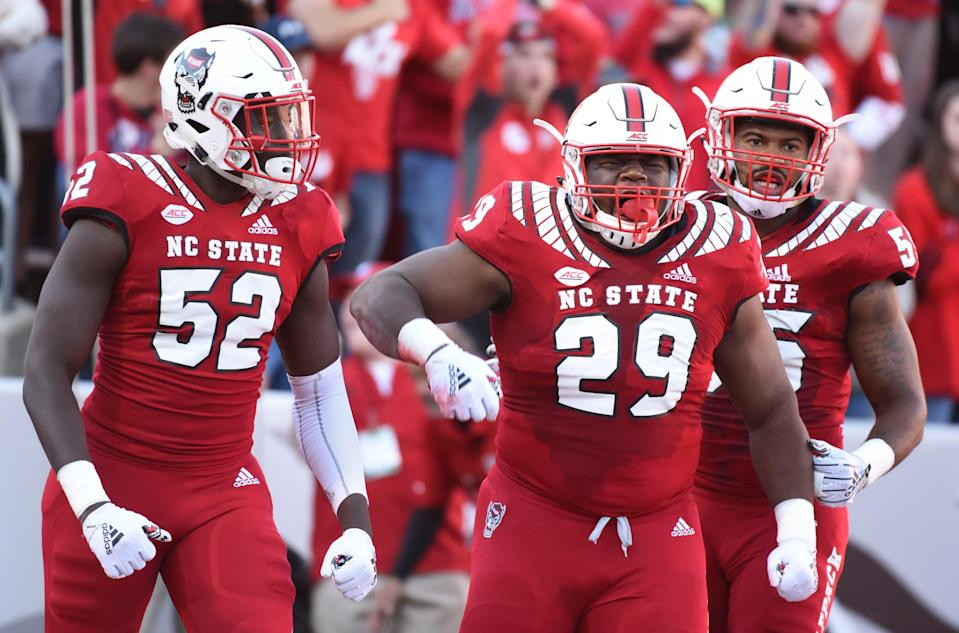 North Carolina State defensive tackle Alim McNeill celebrates a sack against Florida State on Nov. 3, 2018 in Raleigh, N.C.