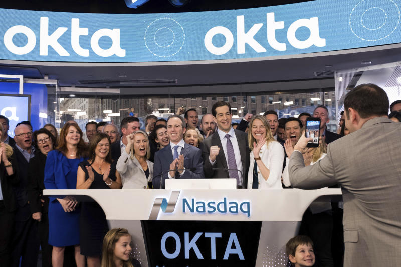 Okta CEO Todd McKinnon, center right, and COO Frederic Kerrest, center left, react after ringing the opening bell to celebrate Okta's initial public offering, at NASDAQ on Friday, April 7, 2017 in New York. (Charles Sykes/AP Images for OKTA)