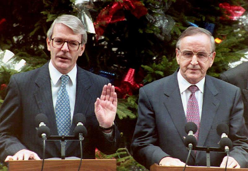In this file photo, then British Prime Minister John Major (L) and Irish Prime Minister Albert Reynolds address a press conference in London, prior to issuing a joint declaration to bring peace to Northern Ireland, on December 15, 1994