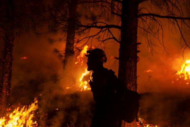 A firefighter participates in nighttime firefighting operations on July 15, 2021 at the Bootleg Fire in Oregon