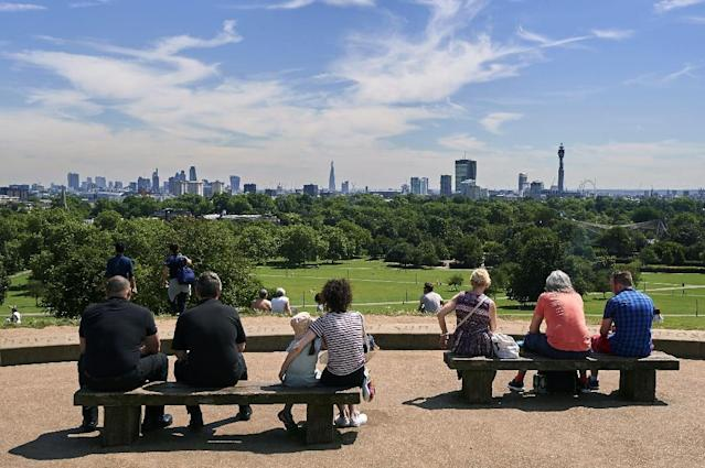 "People bask in the sun at Primrose Hill in north London, as anti-corruption campaigners described London as the ""Death Star"" of global kleptocracy (AFP Photo/NIKLAS HALLE'N)"