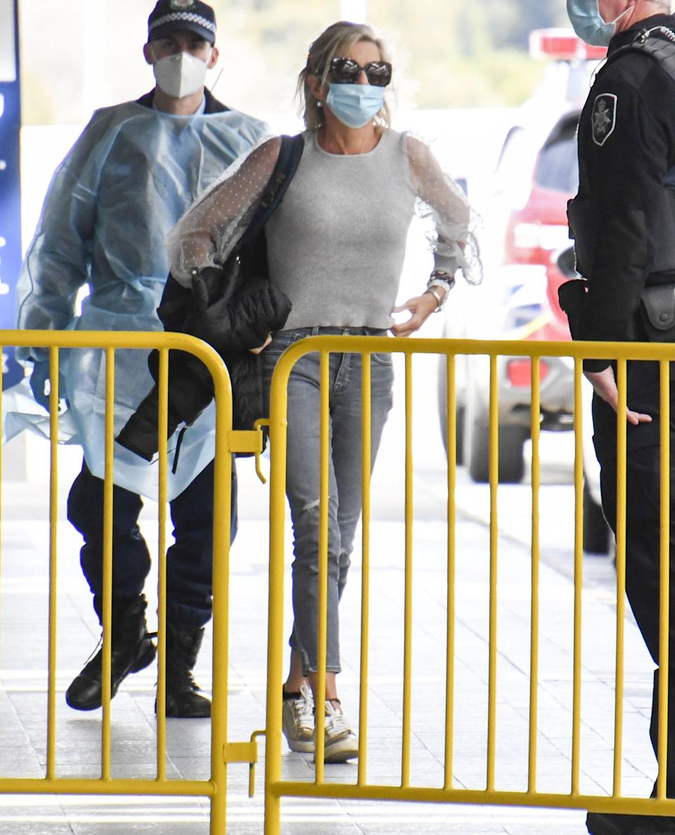 Katie Hopkins has been seen leaving Australia after her visa was cancelled due to a video where she bragged about trying to break quarantine rules. Photo: Media Mode