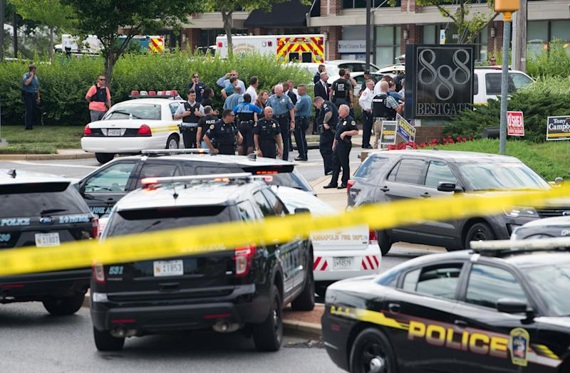 Police respond to a shooting in Annapolis, Maryland, at a building that contains the Capital Gazette newsroom.
