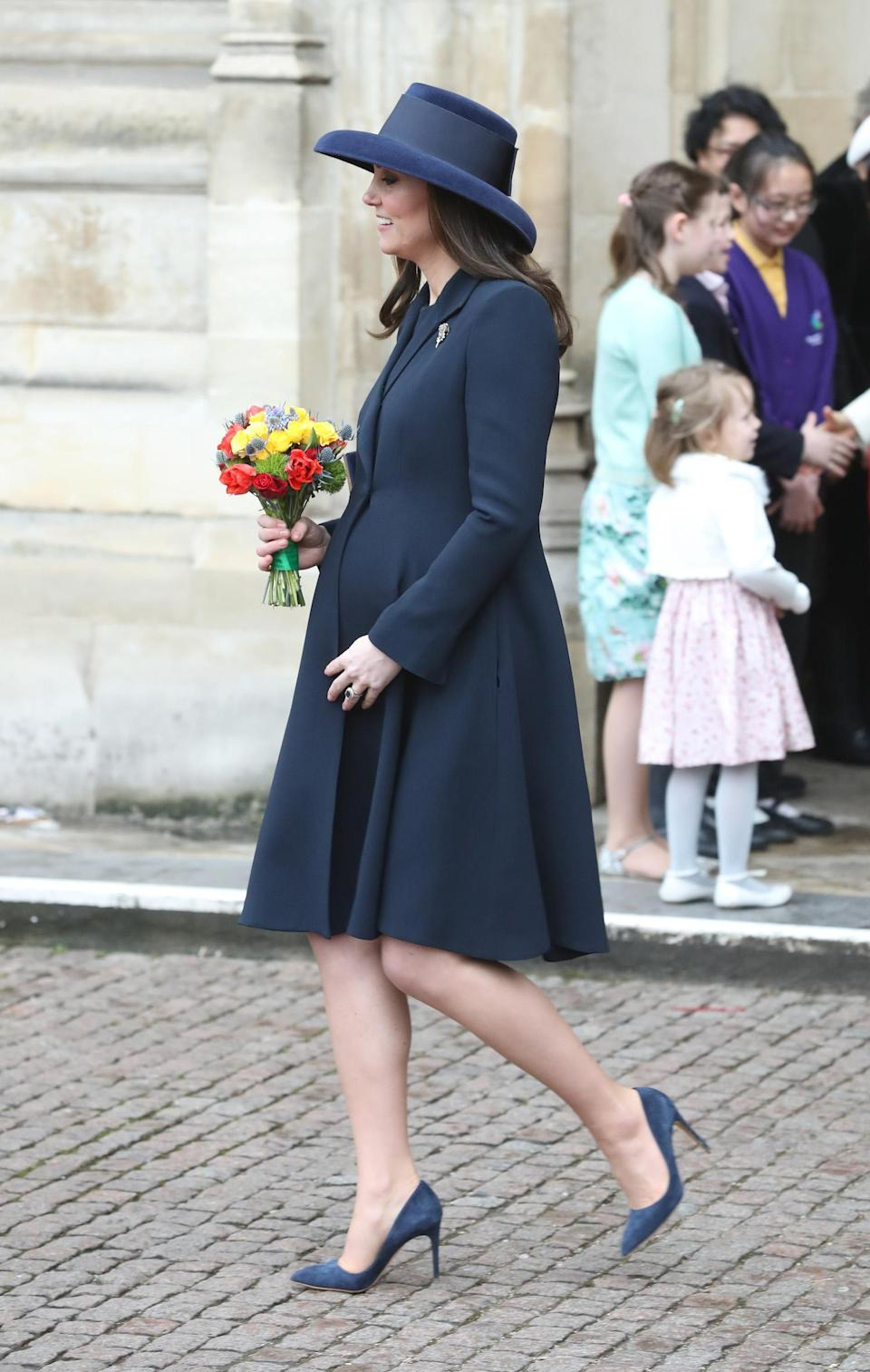 <p>Kate Middleton wears a navy coat and matching hat and heels at the 2018 Commonwealth Day service at Westminster Abbey on March 12, 2018, in London. (Photo: Getty Images) </p>