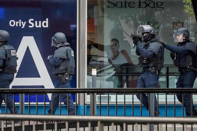 Lockdown: Armed police at the airport (EPA)