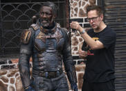 """This image released by Warner Bros. Entertainment shows Idris Elba, left, with director James Gunn on the set of """"The Suicide Squad,"""" in theaters and on HBO Max on August 6. (Jessica Miglio/Warner Bros. Entertainment via AP)"""