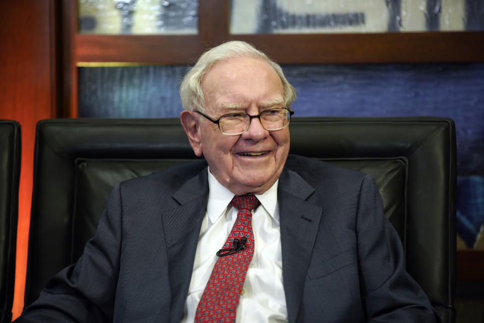 """FILE - In this May 7, 2018, photo, Berkshire Hathaway Chairman and CEO Warren Buffett smiles during an interview in Omaha, Neb., with Liz Claman on Fox Business Network's """"Countdown to the Closing Bell."""" Buffett's company made major new investments in Verizon and Chevron and again trimmed its huge stake in Apple while making several other adjustments to its stock portfolio in 2020. Berkshire Hathaway said in a regulatory filing Tuesday, Feb. 16, 2021, that it bought $8.6 billion worth of Verizon stock and picked up $4 billion worth of Chevron shares over the last six months of 2020. (AP Photo/Nati Harnik, File)"""