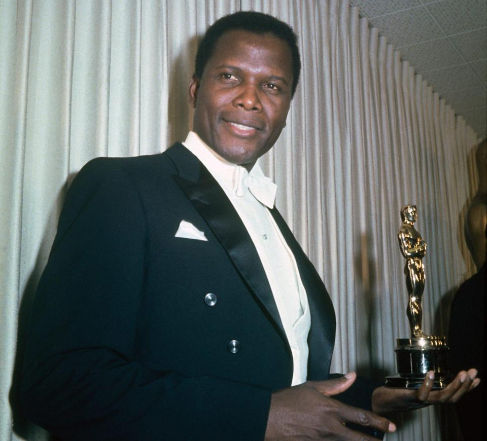 <p>Showcasing his historic Oscar for <em>Lilies of the Field</em> at the 36th Academy Awards in 1964. </p>