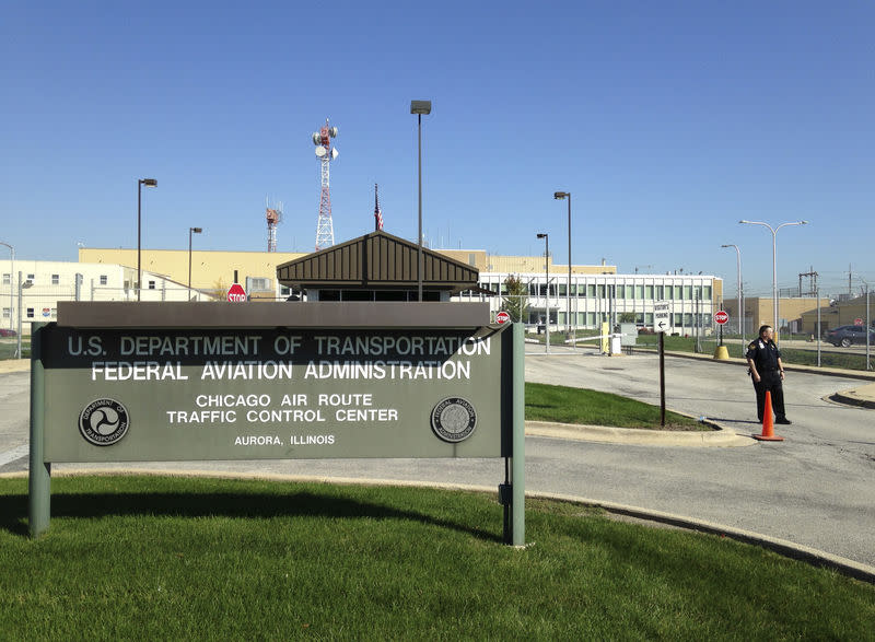 FILE PHOTO: A police officer stands guard outside the FAA air traffic control center in Aurora, Illinois
