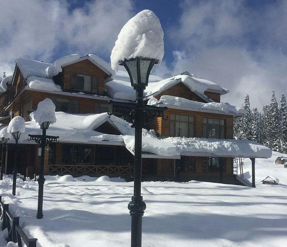 Snow has covered the homes and the streets of Gulmarg