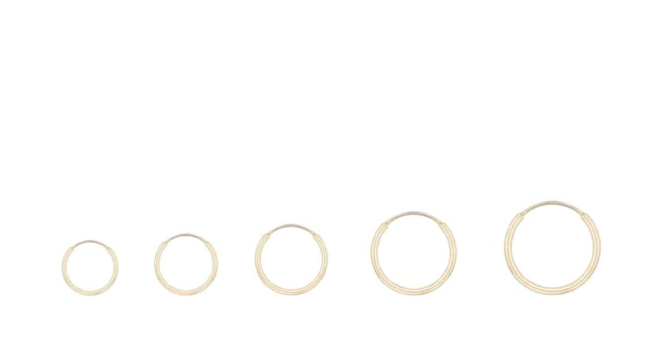 """<p><span>Kendall Conrad Essential Hoops</span> ($150)</p> <p>""""Hoops are timeless, and this small, skinny gold pair are both fun and elegant. The great thing about these is that they're super high quality, so they'll have them for a long time, and add a little something extra to their Zoom meetings."""" - India Yaffe, assistant editor, shop</p>"""
