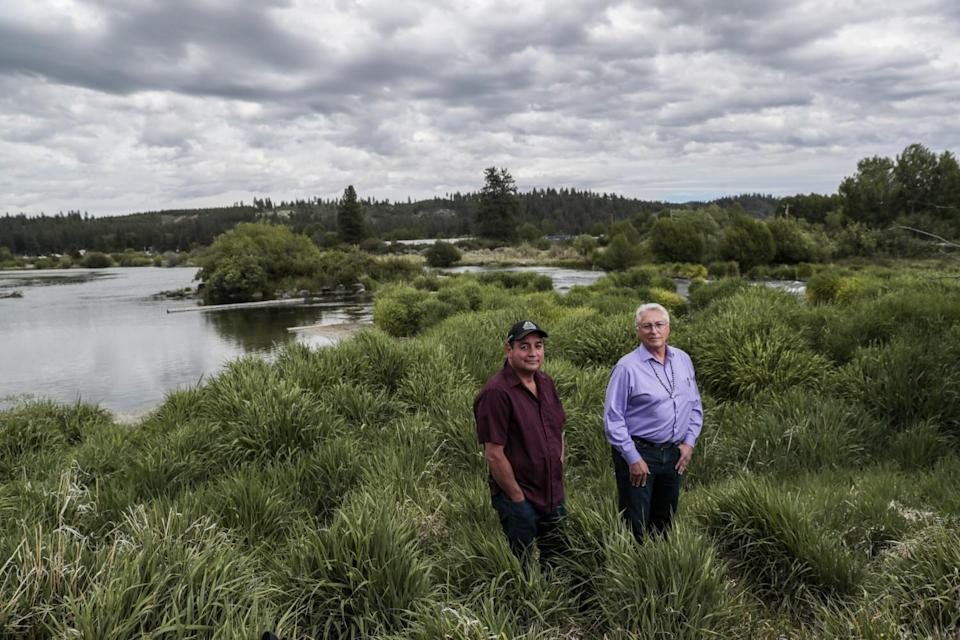 Clayton Dumont, left, and tribal Chairman Don Gentry stand next to the Sprague River