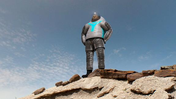 NASA's 'Technology' Z-2 spacesuit design is depicted on some rocks.