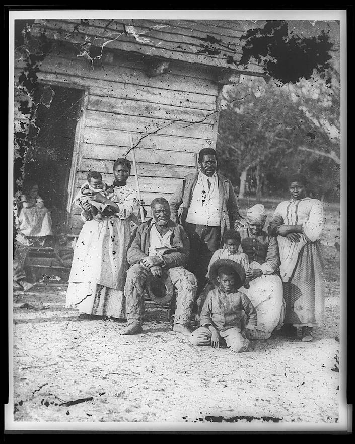 Five generations of slaves are pictured here in front of Smith's Plantation in Beaufort. The plantation was later turned into a U.S. Army camp and is in the present day Town of Port Royal.