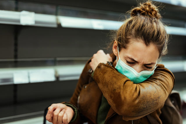 Experts recommend coughing into our elbow rather than our hands to help stem the spread of infection. (Getty Images)