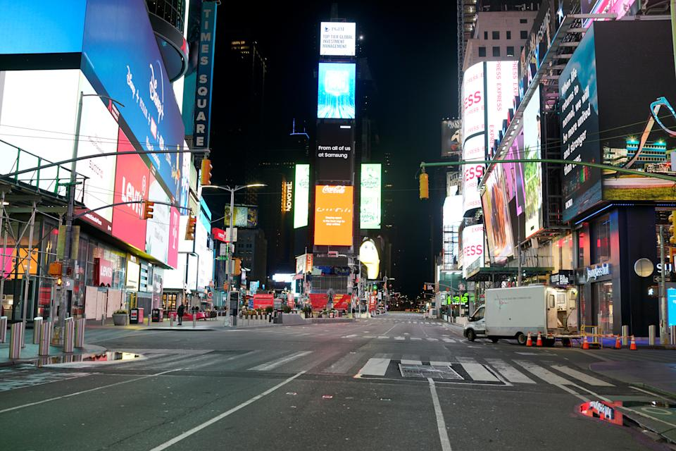 Times Square stands relatively empty of pedestrians and traffic as the outbreak of the coronavirus disease continues in the Manhattan borough of New York, U.S., April 14, 2020. (REUTERS/Lucas Jackson)