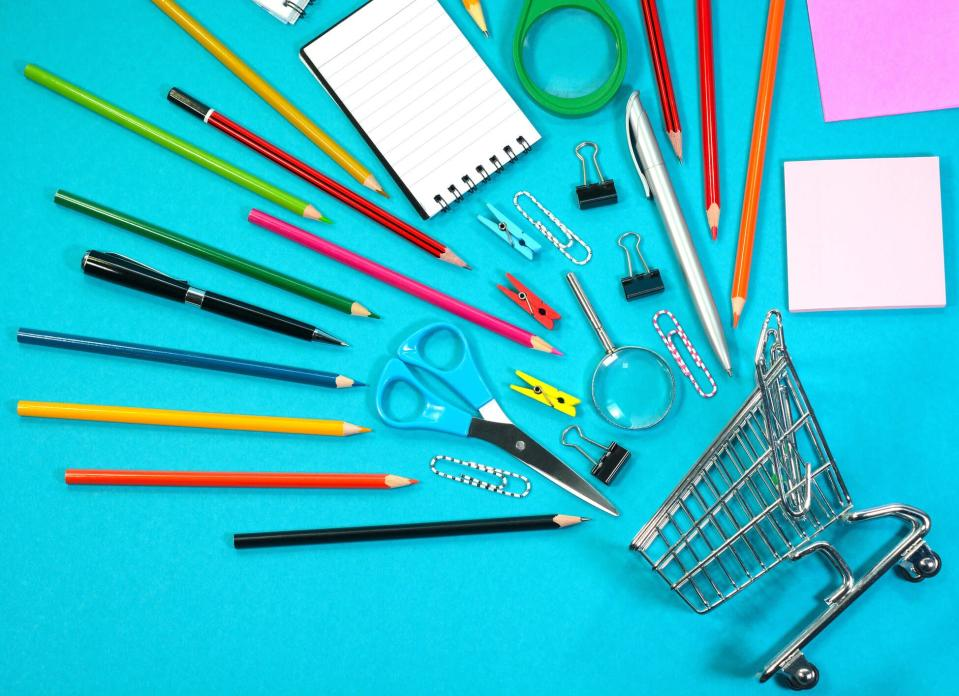 An image of school supplies and a mini grocery cart on a blue background.