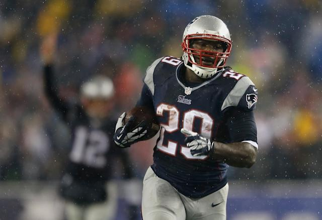 FOXBORO, MA - DECEMBER 29: LeGarrette Blount #29 of the New England Patriots scores a touchdown as Tom Brady #12 of the New England Patriots reacts during a game with the Buffalo Bills at Gillette Stadium on December 29, 2013 in Foxboro, Massachusetts. (Photo by Jim Rogash/Getty Images)