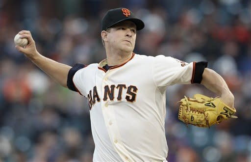 San Francisco Giants pitcher Matt Cain throws to a Miami Marlins batter during the first inning of a baseball game in San Francisco on Tuesday, May 1, 2012. (AP Photo/Jeff Chiu)