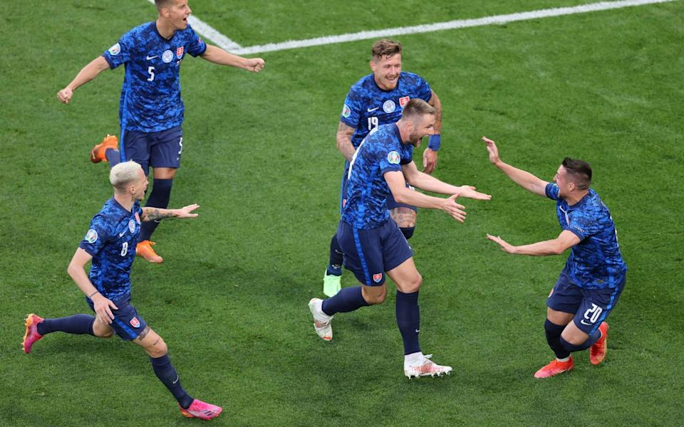 Milan Skriniar celebrates with his teammates after making it 2-1 to Slovakia in the second half - REUTERS