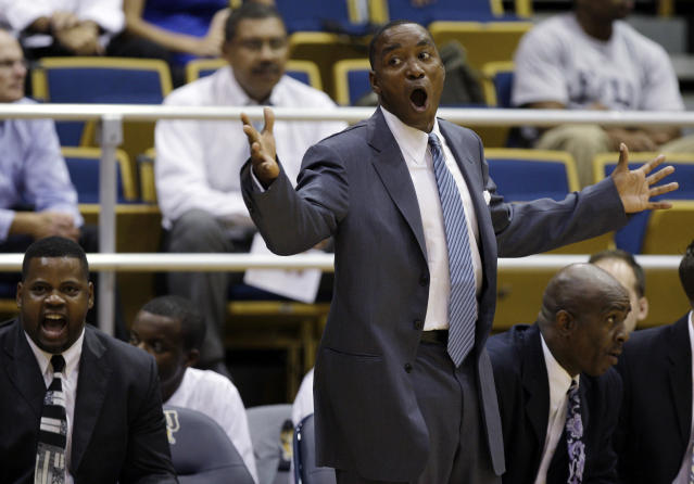 Florida International head basketball coach Isiah Thomas, center, yells from the bench during an exhibition game against Northwood, as associate head coach Anthony Anderson, left, and assistant coach William Eddie, right, look on in Miami, Wednesday, Nov. 4, 2009. Thomas needs to make a winner of little-known Florida International and revive his own career in the process. (AP Photo/Lynne Sladky)