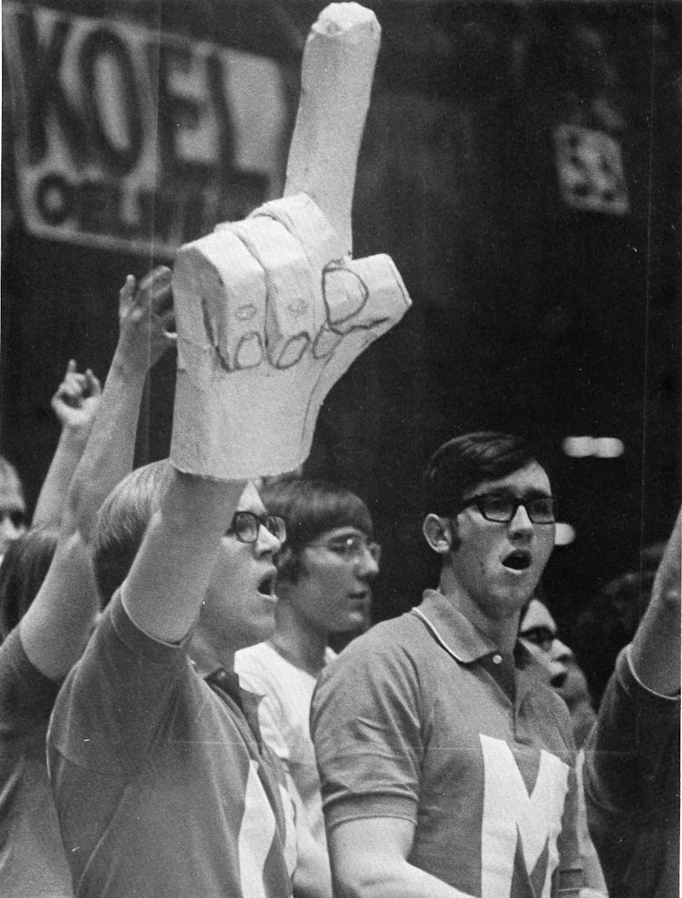<span>Foam finger creator Steve Chmelar brought his homemade creation to the Iowa High School Athletic Association's boys state basketball finals in 1971. The Associated Press snapped a photo of him, which appeared in the <em>Des Moines Tribune</em>, and the No. 1 hand, better known as the foam finger, was born. </span>(Photo: Courtesy of Steve Chmelar)
