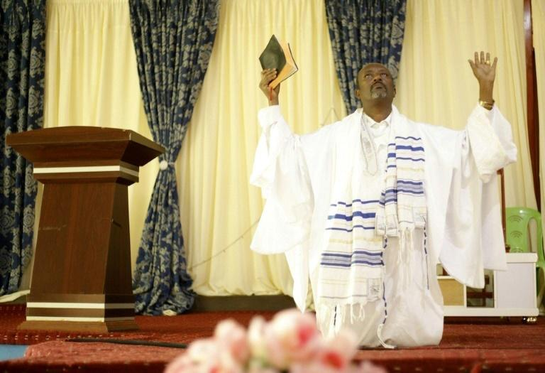 Evangelical leader Tamirat Biranu, seen here praying, says anger is driving young people into the arms of the rebels