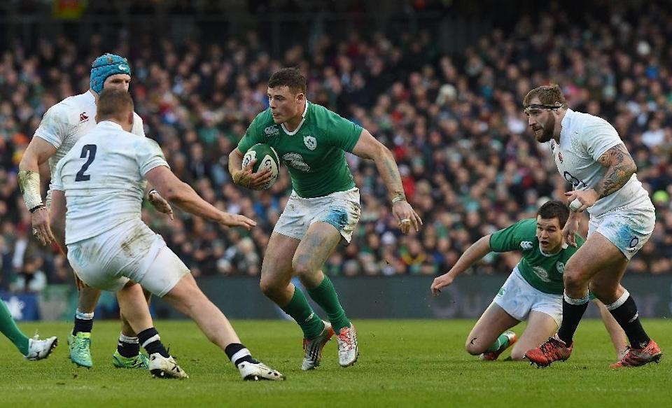 Ireland will be without centre Robbie Henshaw (C) against Romania at Wembley, who coach Joe Schmidt did not want to rush back after a hamstring problem (AFP Photo/Paul Ellis)