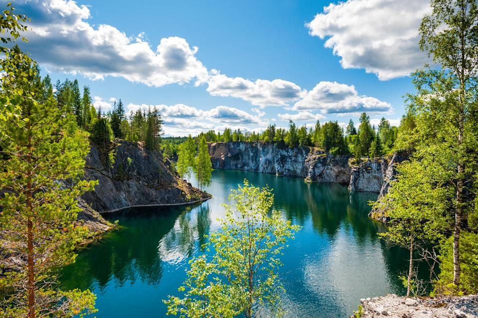<p>Ruskeala, Karelia, is thought to be one of the most beautiful places in the world. It's perfect if you need a break from city life and fancy being surrounded by almost nothing but nature. This republic, in north-west Russia, is more Finnish than Russian influenced and is a great spot for hiking. Take a trip to Ruskeala mountain park to see the crystal clear water and marvel at the light shows during the summer months. <em>[Photo: Getty]</em> </p>
