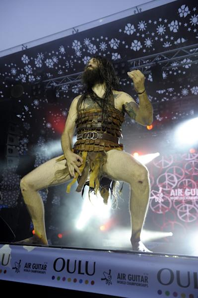 """USA' s Justin """"Nordic Thunder"""" Howard performs at the 2012 Air Guitar World Championshps in Oulu, Finland on Friday Aug. 24, 2012. (AP Photo / LEHTIKUVA / Martti Kainulainen FINLAND OUT"""