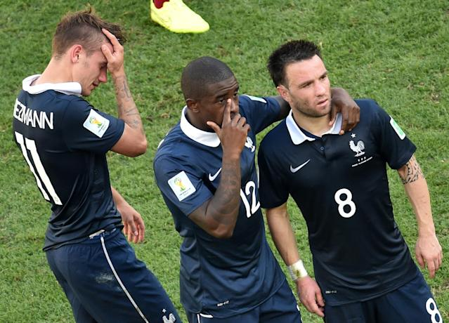 (L/R): France's Antoine Griezmann, Rio Mavuba and Mathieu Valbuena react after their 1-0 defeat to Germany in the quarter-final at The Maracana Stadium in Rio de Janeiro on July 4, 2014, during the 2014 FIFA World Cup (AFP Photo/Francois Xavier Marit)