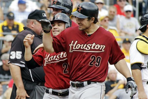 Houston Astros' Brett Wallace (29) is greeted by Jose Altuve (27) after crossing home plate following his three-run home run off Pittsburgh Pirates pitcher Jeff Locke in the fifth inning of a baseball game in Pittsburgh, Monday, Sept. 3, 2012. (AP Photo/Gene J. Puskar)