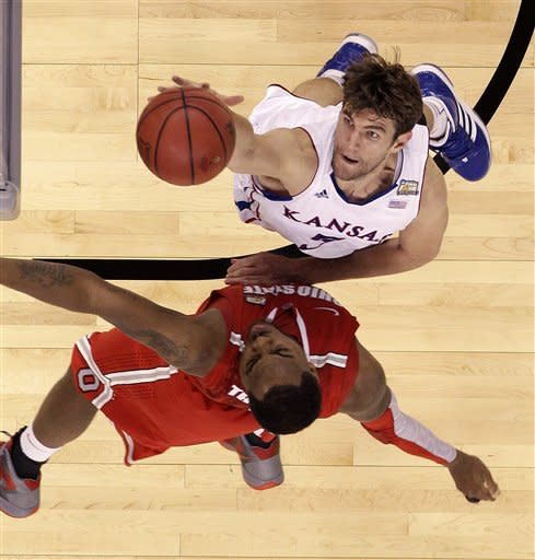 Kansas center Jeff Withey (5) goes to the basket against Ohio State forward Deshaun Thomas (1) during the second half of an NCAA Final Four semifinal college basketball tournament game Saturday, March 31, 2012, in New Orleans. (AP Photo/David J. Phillip)