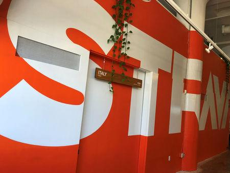 The logo of Strava Inc covers a wall at the fitness app company's headquarters in San Francisco, California, U.S., March 7, 2018. Picture taken on March 7, 2018.  REUTERS/David Ingram