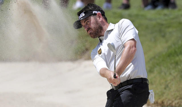 Louis Oosthuizen hits from the bunker on the first hole during the final round of the Valspar Championship golf tournament Sunday, March 24, 2019, in Palm Harbor, Fla. (AP Photo/Mike Carlson)