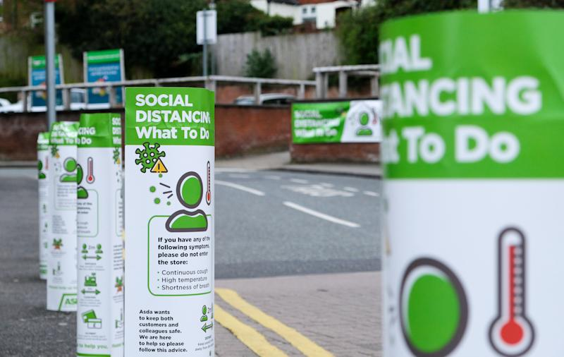 SHEFFIELD, UNITED KINGDOM - APRIL 18, 2020 - Coronavirus: social distancing signs outside an Asda store- PHOTOGRAPH BY Matthew Chattle / Barcroft Studios / Future Publishing (Photo credit should read Matthew Chattle/Barcroft Media via Getty Images)