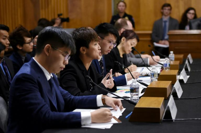 Hong Kong activist Joshua Wong (L) listens to testimony by singer-campaigner Denise Ho (C) before the US Congress (AFP Photo/Olivier Douliery)